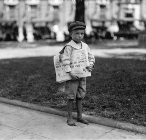 Lewis Hine - 7 year old Ferris. Tiny newsie who did not know enough to make change for investigator. Mobile, Alabama, 1914